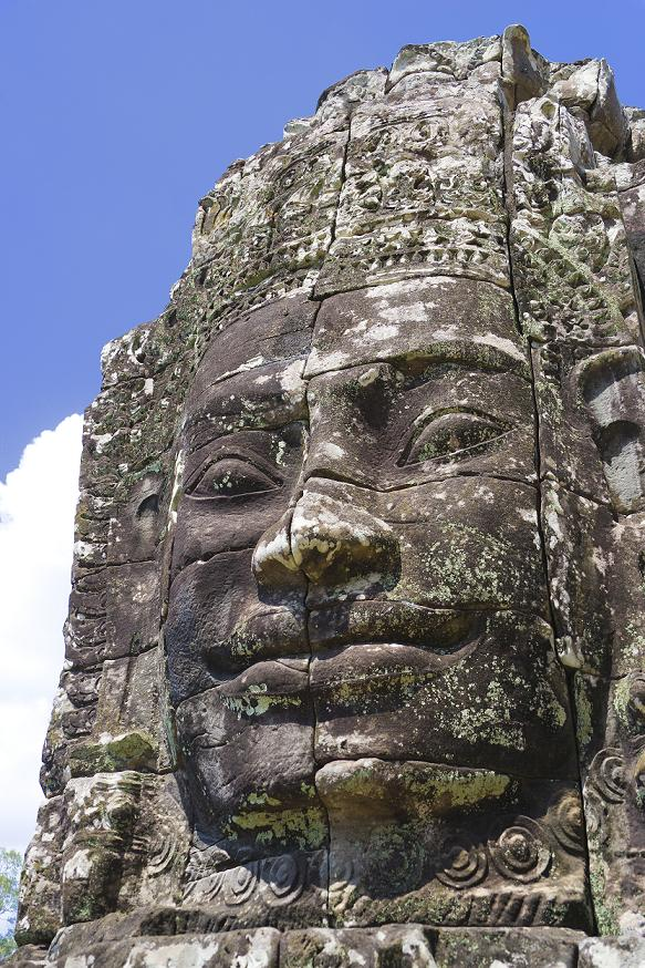 Image of Buddha's face at UNESCO's World Heritage Site of Bayon, which is part of the larger temple complex of Angkor Thom, located at Siem Reap, Cambodia. This is one of the temples in Siem Reap where the Hollywood movie Lara Croft Tomb Raider was filmed at.