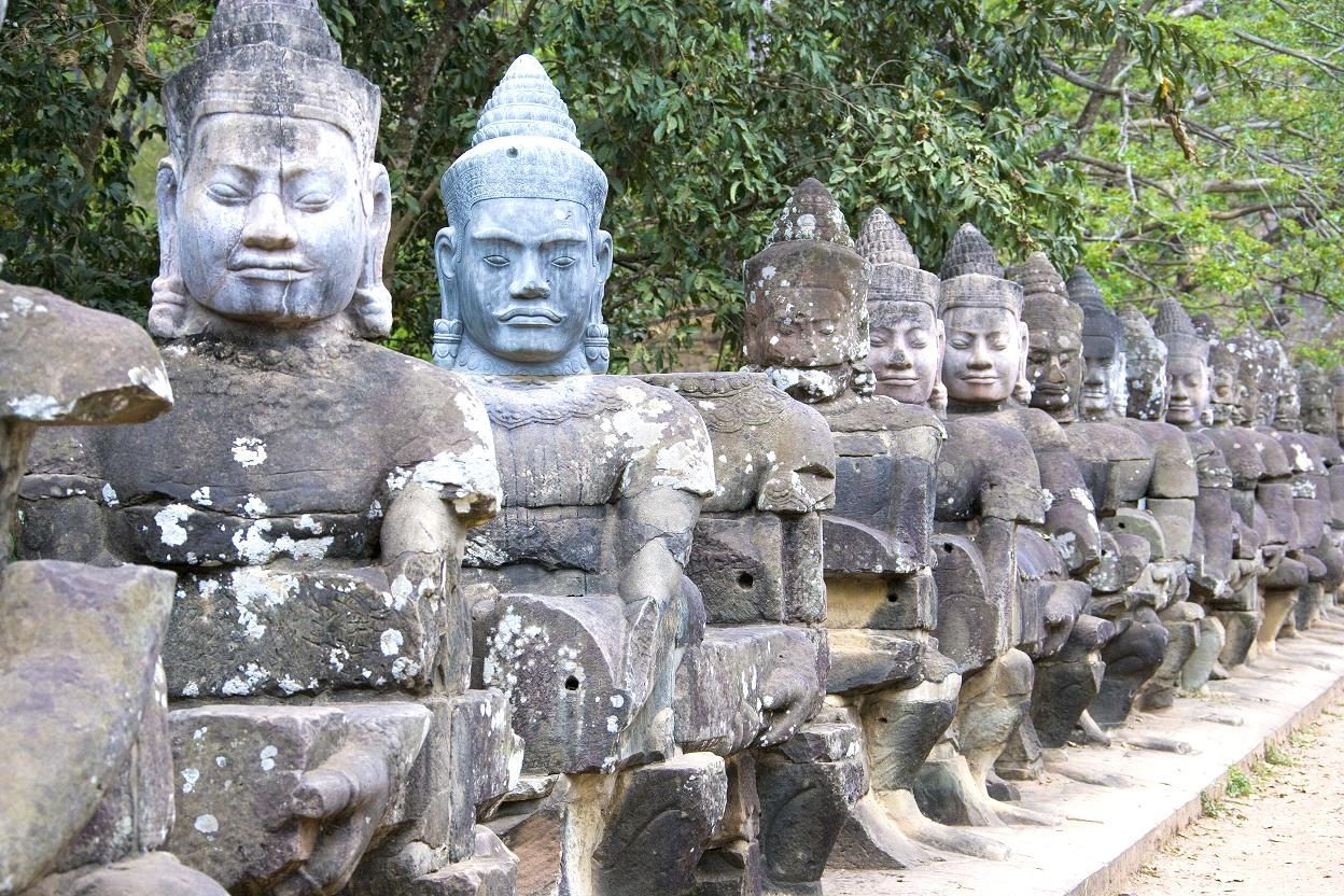 Image of ancient statues of gods at the South Gate of UNESCO's World Heritage Site of Angkor Thom, Siem Reap, Cambodia.