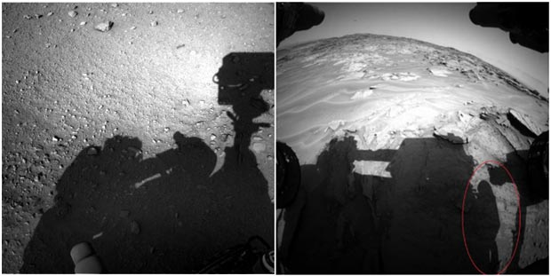 And here a shadow of the person in a space suit with a satchel performing some service inspection of the mars rover